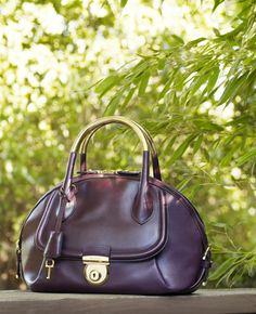 55af6b215951 Fiamma in plum leather with gold handle. Explore  theFIAMMA at www.Ferragamo .