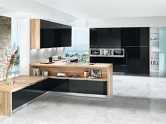 Kitchen shown in black acrylic gloss finish with light matt reproduction oceano