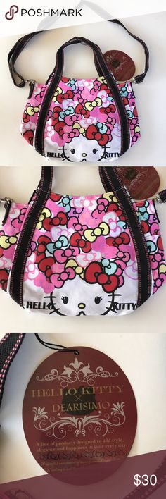 NWT Sanrio Hello Kitty x Dearisimo purse NWT Hello Kitty x Dearisimo purse. Beautiful print. Two outside side pockets. Inside pocket with zipper and small pick with 2 pen holders. Two handles strips and adjustable, removable Over the shoulder strap Sanrio Bags Shoulder Bags