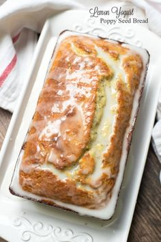 A tender, very moist bread full of bright lemon flavor and draped in a sweet-tart icing. ~ https://www.fromvalerieskitchen.com