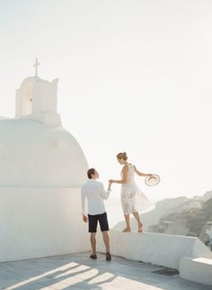The ultimate inspiration for any couple planning a destination elopement in Santorini, complete with breathtaking images from photographer KT Merry.