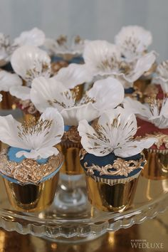 These Anna Karenina-inspired #cupcakes look almost too good to eat with their sugar flower toppings. | Photography: lifeimages | WedLuxe Magazine #luxury #wedding #annakarenina #russian #gold #icing #sugarflower #cupcakedecorations