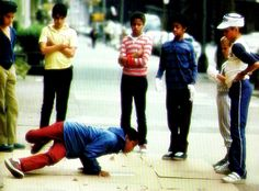 Breakdancing in Harlem, ca. 1980s | Breakdance, the oldest known hip-hop style of dance, is believed to have originated in the Bronx, New York in the 1970's. Sonic inspirations date back to the energetic performances of funk maestro, James Brown. In the early days of djing, emceeing, and b-boying, a break - instrumental part of a song that is looped repeatedly by the DJ - were incorporated into songs to allow a showcase of improvised breakdance steps.