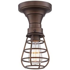 a vintage style edison bulb enhances the industrial appeal of this oilrubbed bronze ceiling