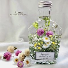 Glass Bottles, Glass Vase, Perfume Bottles, Ikebana Flower Arrangement, Floral Arrangements, Flower Bottle, Floating Flowers, Metal Dining Table, Beautiful Perfume