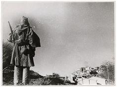 Republican soldier standing guard, Teruel, Spain, 1937-38//Robert Capa