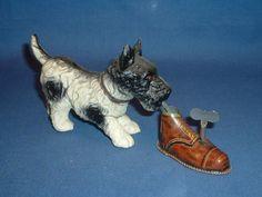Vintage Tin Toy wind~up Dog with shoe // photo via web...