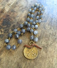 Beautiful 7mm gray Agate faceted beads are wire wrapped with antiqued gold vermeil chain featuring a stunning artisan bronze Spanish coin.
