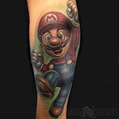 The Super Mario Brothers will always be a crowd favorite. Check out 10 awesome Mario Party tattoos as we reminisce on the days of Nintendo Mario Brothers Games, Super Mario Brothers, Super Mario Tattoo, Nintendo Tattoo, Gamer Tattoos, Top Tattoos, Tatoos, Party Tattoos, Tattoo Videos