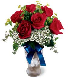 An Unforgettable Moment  Radiant and rich, these exquisite red roses brim with elegance and grace. Classically beautiful, these velvety, vibrant blooms make a sweet smelling and breathtakingly lavish gift!