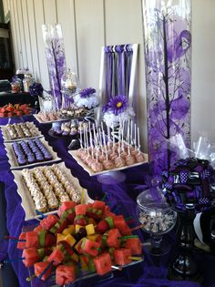 Purple and Zebra birthday party dessert table. A bit over the top for my purposes but snacks and presentation are a great idea. Looks like rice krispie treat pops with purple icing in back, LOVE it.