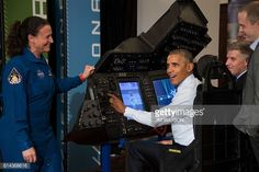US President Barack Obama is shown how to operate a spacecraft flight and docking simulator with NASA Astronaut Dr Serena AunonChancellor as he tours...