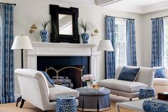 Blue and white living room with fireplace. Styled by StacyStyle for @New England Home. Photo by Sam Gray.