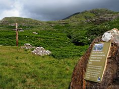 This cross was erected in the memory of the banished, lost, and forgotten and those lying here in unmarked graves. Memorial cross in The Lost Valley of County Mayo. Ireland travel tips | Ireland vacation | IrelandFamilyVacations.com