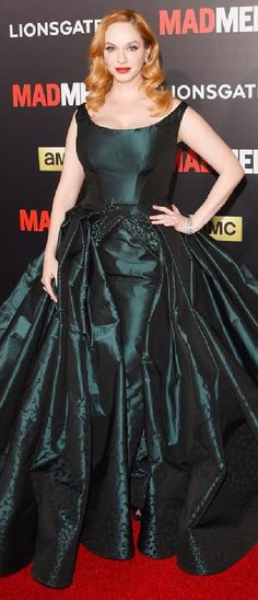 Christina Hendricks cranked up the drama at the Mad Men Black & Red Ball in a teal butterfly-embroidered taffeta Zac Posen gown with an incredible sweeping detachable ball skirt.