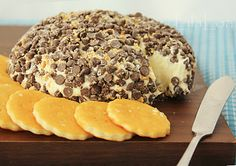 White Chocolate Cheesecake Ball     (8 ounces cream cheese, softened  2 Tablespoons butter  1 cup white chocolate chips  3/4 cup powdered sugar  1/4 teaspoon salt  1 cup mini chocolate chips  2 graham crackers)