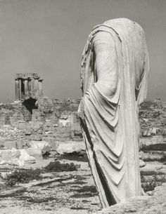Statue and Temple of Apollo in the background, Corinth, Peloponnese, Greece, 1937.  Photo by Herbert List