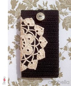 Black beige smart phone crochet cover by Anabelia - no pattern, but beautiful - use different doily patterns?