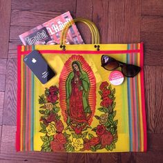"""Woven Tote! Both sides have a unique Reyna portrait, the iconic Mexican portrait. The perfect summer tote. Beach, office, farmers market.... Look stylish no matter what. Silk screened and direct from a woman owned artesian market in Mexico City. 15"""" L X 17"""" W X 5"""" D. Handle drop is 4"""". Tassel sold separately. Costume Baldor Bags Totes"""