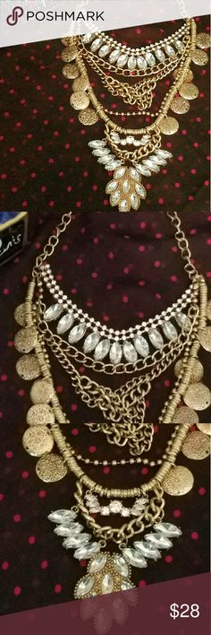 BOHO FESTIVAL STATEMENT NECKLACE GOLDTONE METAL BOHO FESTIVAL STATEMENT NECKLACE OVERALL LENGTH 15 INCHES CHAIN LENGTH WITH EXTENDER  IS ROUGHLY 20 INCHES FAUX COINS AND CRYSTALS WITH ALOT OF CHAIN DETAIL PRICE FIRM UNLESS BUNDLED SORRY NO TRADES Jewelry Necklaces
