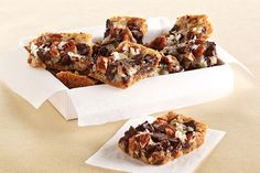 Chocolate Chunk-Magic Cookie Bars - Chocolate, pecans and tender coconut sit on a crunchy graham cracker crust. What's really magical is that these cookie bars will disappear into thin air!