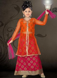 Portland Orange and Magenta embroidered party lehenga choli intricate with zari thread, floral work, leaf work and patch patti border.Available with Portland Orange Brocade Choli and Magenta Net Dupatta.This lehenga choli is stitched and can be customized Indian Dresses For Girls, Kids Indian Wear, Girls Dresses, Kids Outfits Girls, Kids Girls, Girl Outfits, Girls Wear, Long Choli Lehenga, Lehenga Blouse