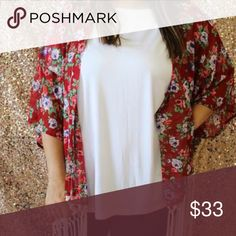 Floral Kimono 100% Polyester. True to size. Model is wearing a size medium. Firing detail at bottom. Mittoshop Tops