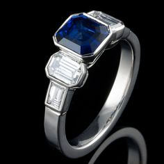 Art Deco style 5 stone engagement ring, handmade in solid platinum and set with a velvet blue natural sapphire and matching white diamonds.    If you are interested in commissioning a bespoke engagement ring, see our website at www.danielprince.co.uk or contact us for a free and private consultation.