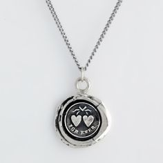 Hearts Talisman Necklace    This handcrafted talisman necklace features two hearts tied with a ribbon symbolic of the uniting of two souls and reads Forever.