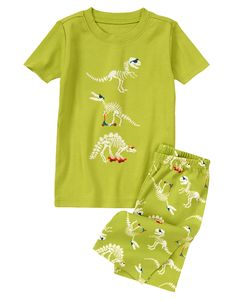 Cool dinos on scooter and skateboard! Fun two-piece pajama set features embroidered detail on the colorful top. Matching shortie bottom easily pulls on for comfort.