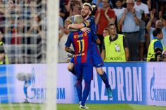 Barcelona's Argentinian forward Lionel Messi (up) celebrates a goal with teammate Barcelona's Brazilian forward Neymar during the UEFA Champions League football match FC Barcelona vs Celtic FC at the Camp Nou stadium in Barcelona on September 13, 2016. / AFP / JOSEP LAGO