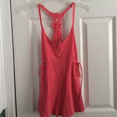 NWT American Eagle pink flowy tank top! Never worn! perfect condition! has strings on the side to make the shirt more fitting! American Eagle Outfitters Tops Blouses