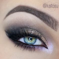 Shimmery gold & deep grey shadows on lid & crease, along w/ a touch of grey & lavender on lower lash line.