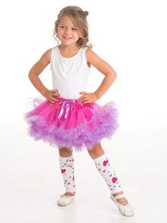It's irresistible to twirl jump and dance in this fun fluffy fuchsia and light purple tutu. Three layers of shimmery fuchsia fabric are accented by light purple ruffled edges. The soft elastic waist is detailed with an adorable matching light purple ribbon.