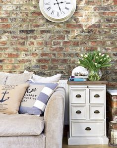 Neutral tones and nautical-themed cushions give this pretty space a coastal scheme without going overboard (excuse the pun)