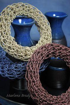 Knitting loom, paper twine bracelets.