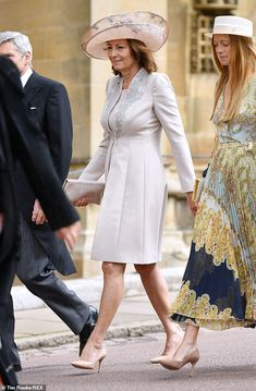 Meanwhile Kate and Pippa's mother Carole Middleton donned a stunning pale pink suit dress . Pippa And James, Kate And Pippa, Carole Middleton, Middleton Family, Blue Bridesmaids, Blue Bridesmaid Dresses, Royal Look, Pink Suit, Royal Weddings