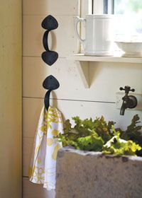DIY home decor. Use a door handle to hang hand towels or use it in your closet for scarves.