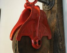 Vintage Barn Pulley Light with back pipe hanging set. This listing features an antique wood block, metal sheave pulley with a vintage-looking, yet new, twisted cloth cord (18 gage wire) and a solid oil rubbed bronze relief light socket with on/off switch.  Barn Pulley: - antique pulley (12 long x 4 wide) - a solid antique brass finish light fixture (Medium E26 Standard Base, UL Listed, Rated for up to 250 Watts / 250 Volts) - light socket hangs 6 off pulley - cord length as pictured...