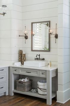 "Vanity paint color is ""Sherwin Williams SW 7017 Dorian Gray"". Wall color – ""Benjamin Moore White Dove"". Countertop – Cambria – Torquay"