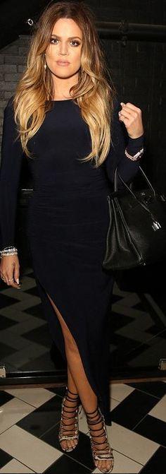 Who made  Khloe Kardashian's black tote handbag, snake lace up sandals, and navy blue long sleeve maxi dress?