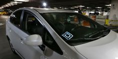 A  driver for Uber Technologies Inc., arrives at an authorized customer pick up area at Seattle-Tacoma International Airport, in Seattle. A federal judge in Seattle on Tuesday, April 4, 2017, temporarily blocked the city's first-in-the-nation law allowing drivers of ride-hailing... http://usa.swengen.com/judge-puts-hold-on-seattles-uber-unionization-effort/