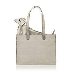 Take it with you with Doggy Bag. This natural canvas and silver metallic nappa shopper features a dachshund pouch that slides into an internal pocket just enough to keep its head and tail peeking out over the edge. Bringing new meaning to the term 'purse dog,' this loveable handbag duo is a true CO original.  |Charlotte Olympia