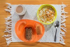 Chocolate milk, cornflakes, banana cake and bisnaguinha, a sweet white bread popular with Brazilian children and served with a mild cream cheese called requeijão.