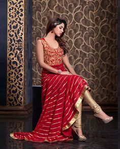 Red Suit with golden embroidered yoke   1. Red suit net with golden embroidered yoke2. Can be stitched upto size 42inches