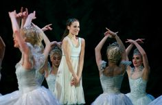 Emma Maguire as Clara with the Snowflakes in Act 1 of the Royal Ballet's The Nutcracker. Photo by Alice Pennefather