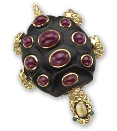 A ruby, emerald and citrine brooch, Seaman Schepps