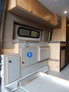 Inteior view of upgraded compartments in a custom Sportsmobile van conversion.