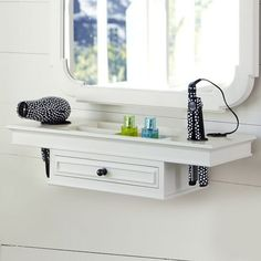 getting-ready space. The mirror has a carved wood frame in white. The matching shelf has a broad surface for holding a hair dryer, while the drawer holds additional primping accessories. Shelf: 27 wide x 9.5 deep x 6 high Shelf features a drawer and four storage cubbies. Key-hole mounting(hardware included)