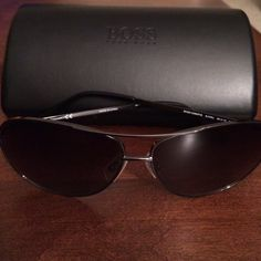 Hugo Boss Sunglasses Hugo Boss Original Aviator sunglasses in gunmetal tone. They have been gently worn by my husband but style is unisex. Original cleaning cloth, bag and case. Hugo Boss Accessories Sunglasses